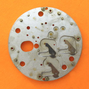ESA 9210 Calendar Platform 2551 Oscillator Side Hammers and Springs Only. Another shot of this plate but now with most of the chronograph mechanism removed. All that is left are the three hammers and their springs for zeroing the two sub dial hands and the main centre second hand.