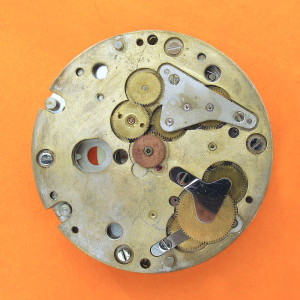 ESA 9210 Chronograph Mechanism Platform 8281 Oscillator Side Built Up. Undo those 4 screw around the periphery at your peril. This is back (oscillator side) of the chronograph module and shows the wheels driving the 3 sub-dials. The central copper coloured wheel is the Chronograph Driving wheel (8058) which is a tight push fit on the centre second counter.