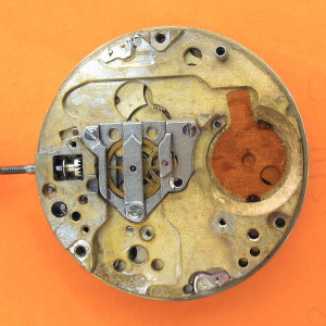 ESA 9210 Main Plate 100 Oscillator Sidedoesn't affect the movement. This houses the keyless works and shares only a few parts with the normal ESA 9162 /Omega f300 movement. You'll notice that the nickel plating has largely been lost on this plate due to battery corrosion. I re-newed the Train Wheel Bridge which is why that looks so much better. The loss of nickel doesn't affect the movement.