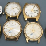 Gold plated cased Gruens with PUW and ESA movements; front view.