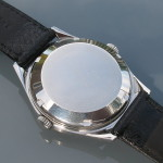Swisselectric watch with its asymmetric case. Case back details.